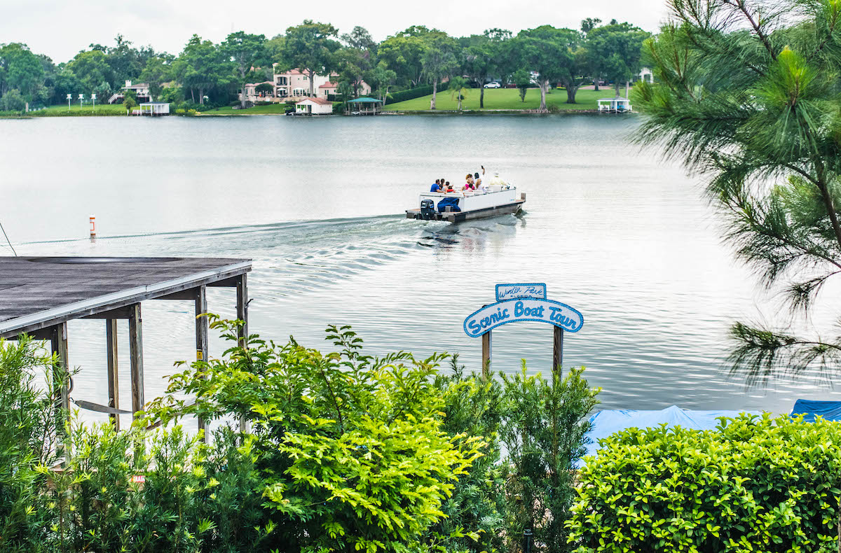 A boat depart from the dock on Lake Osceola.