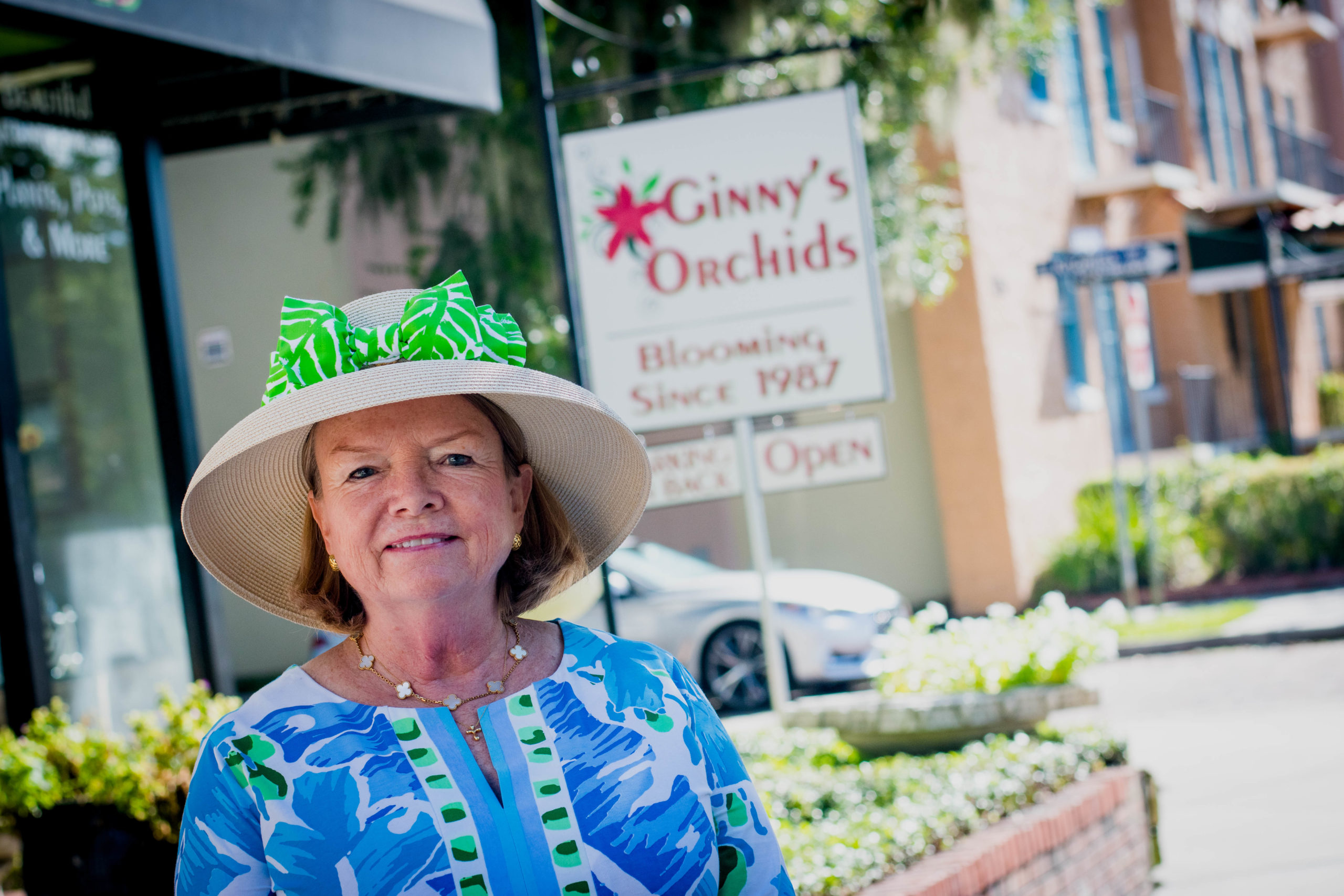 Ginny Enstad stands in front of her shop, Ginny's Orchids, located on Morse Boulevard.