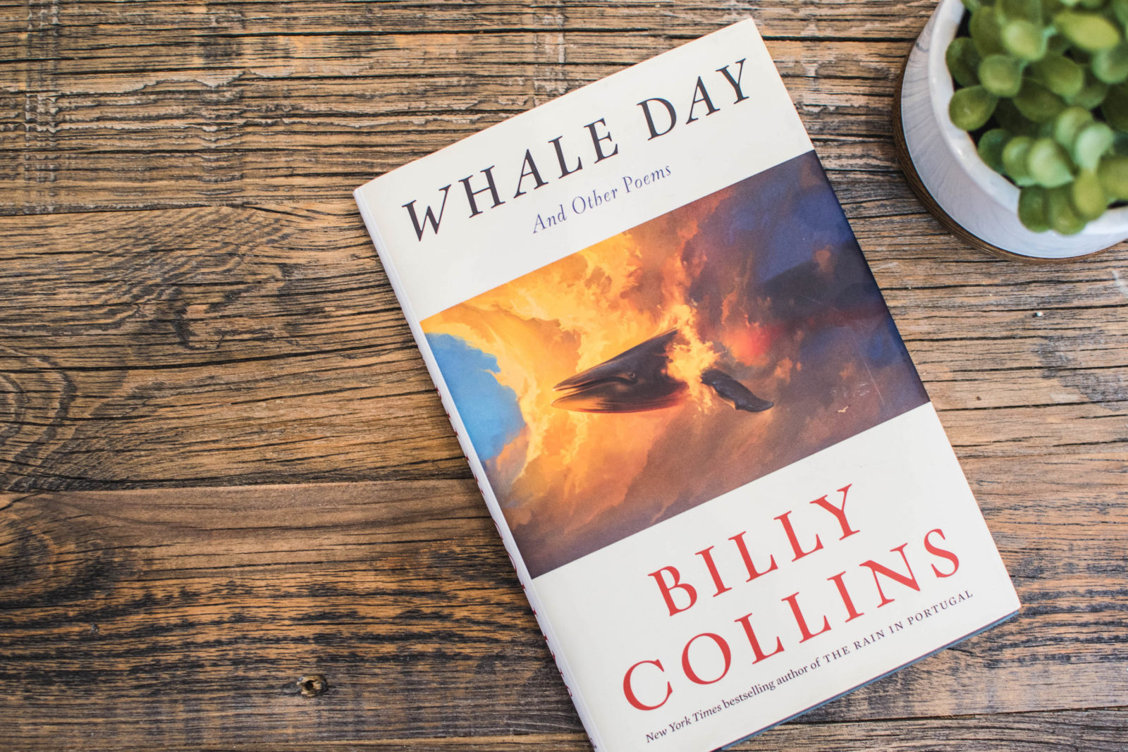 "Billy Collins' newest book, ""Whale Day: And Other Poems"" lays on a coffee table."