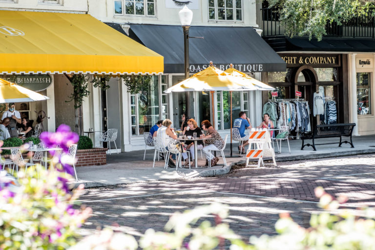 A group dines outdoors at the Briarpatch restaurant on Park Avenue.