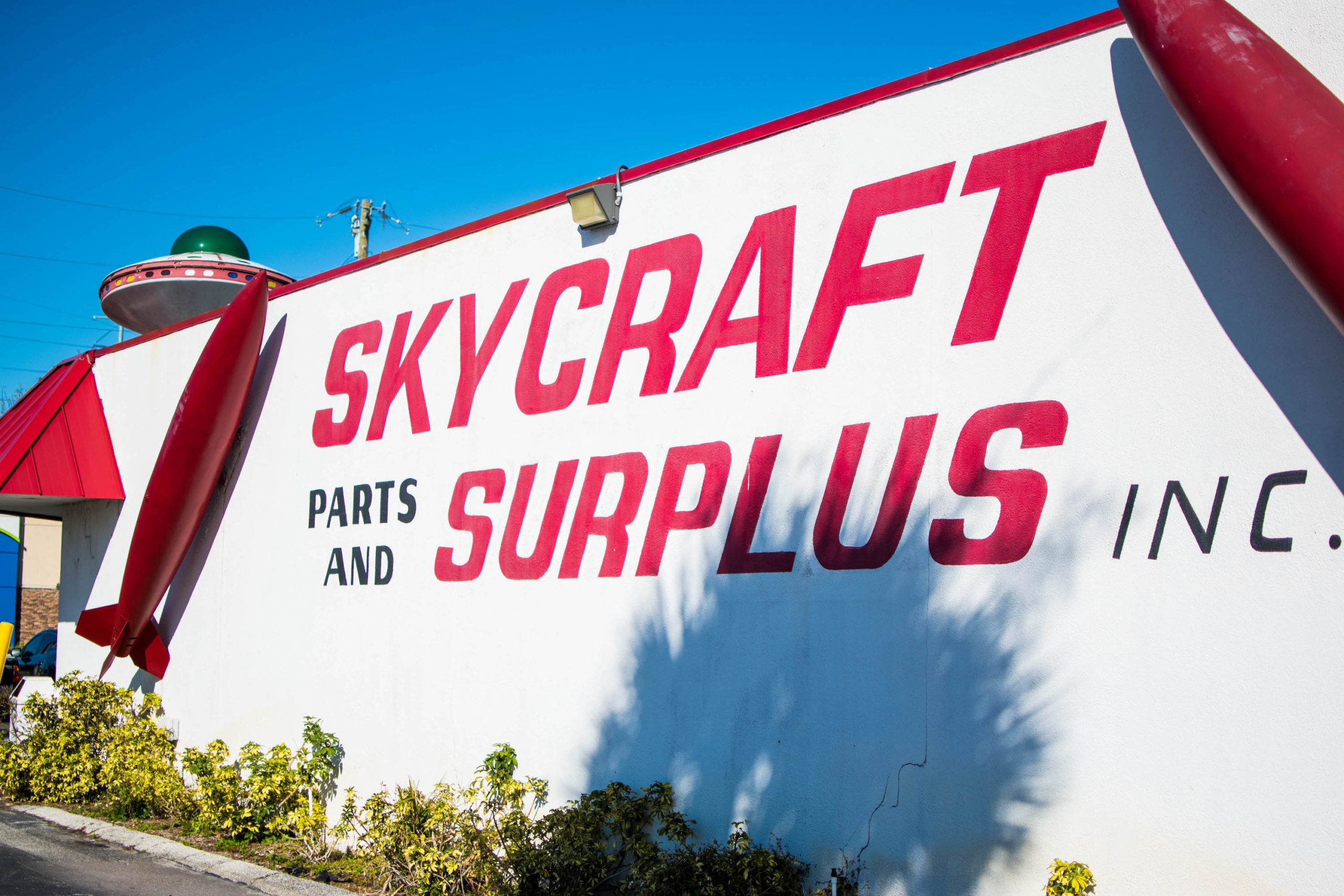 Red Skycraft Parts & Surplus building sign.