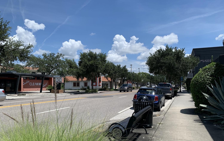 Cars parked along Orange Avenue in Winter Park, FL.