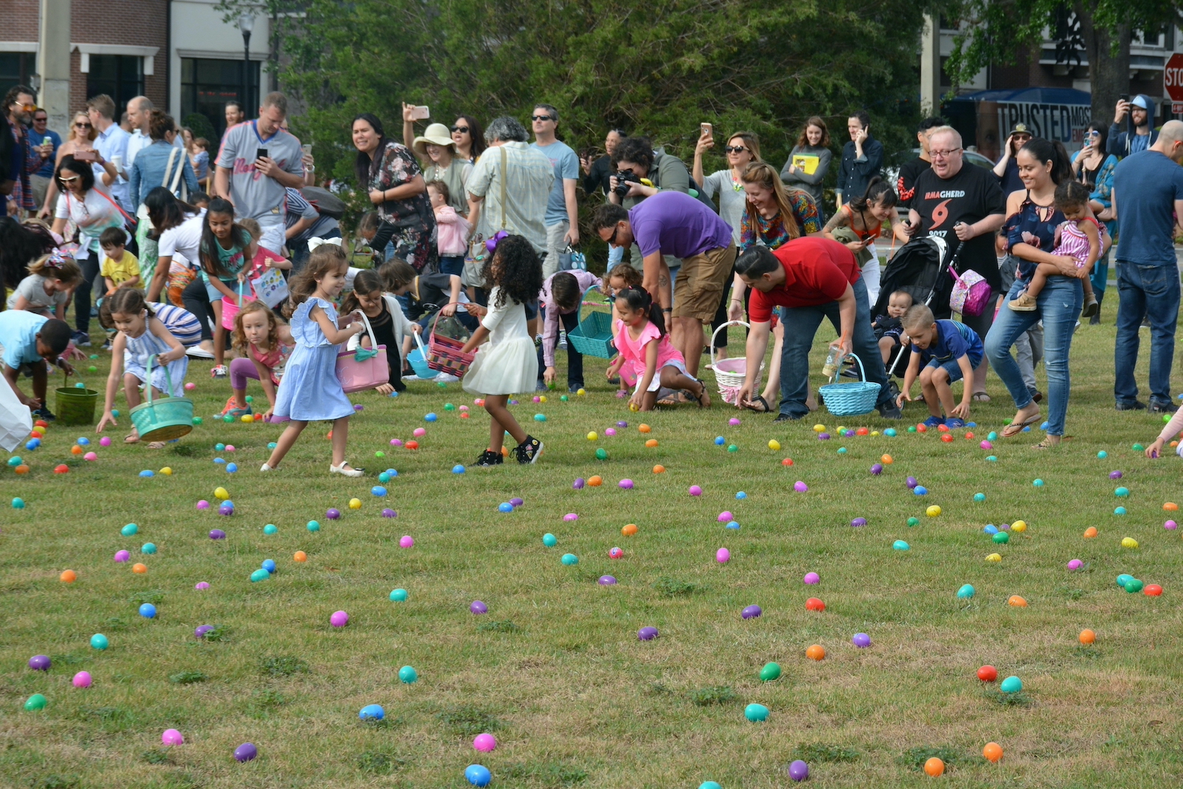 Children collect Easter eggs at annual egg hunt in Central Park.