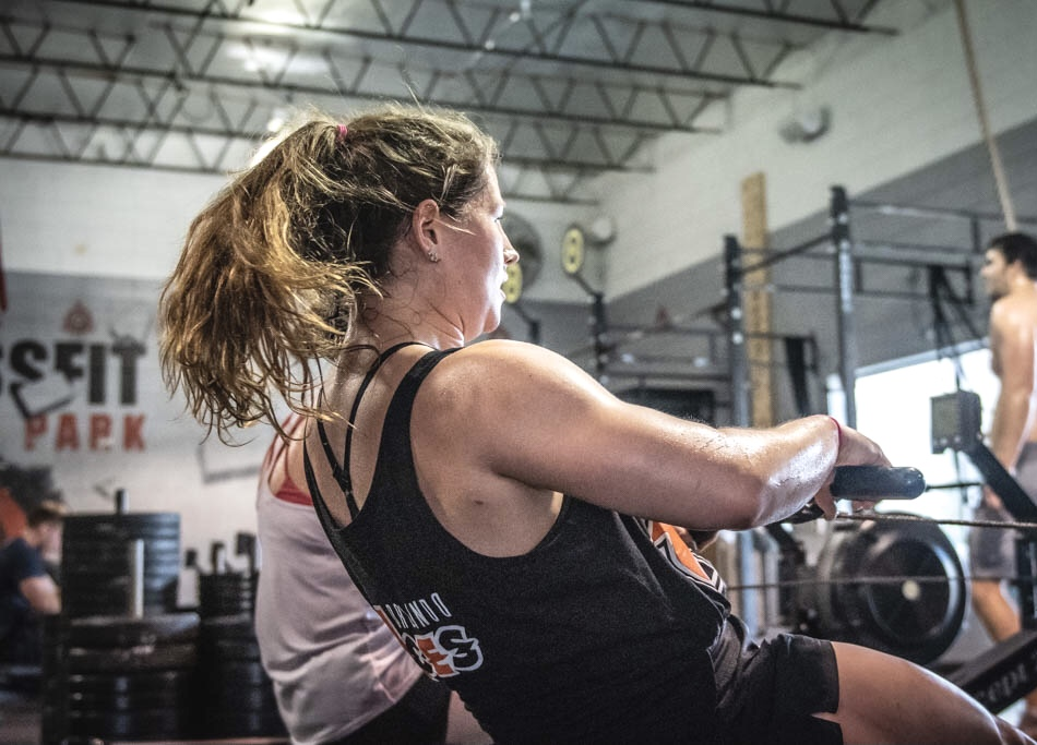 Photo shows woman with light colored hair working out.