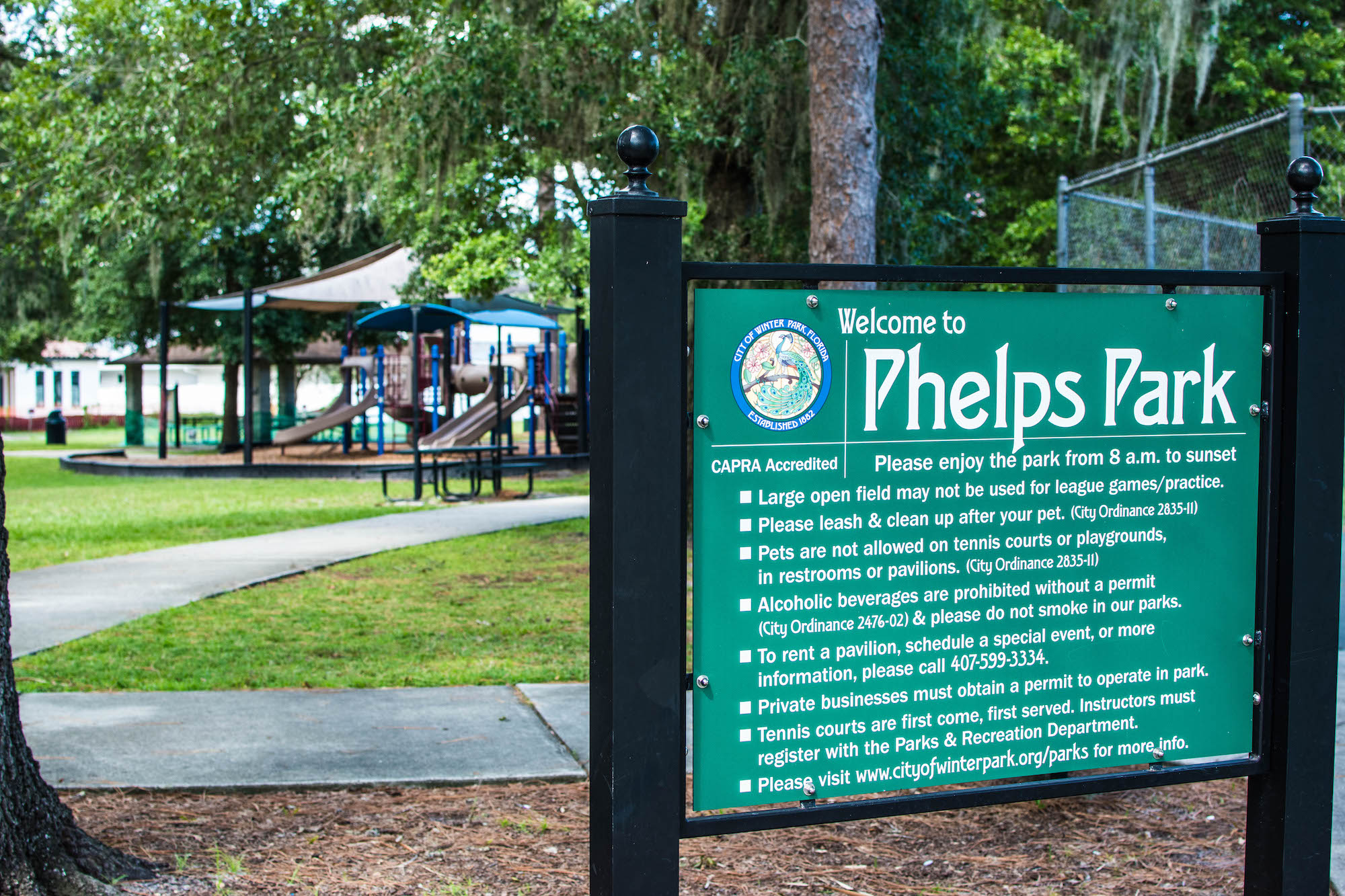 Phelps Park sign in front of the former playground.