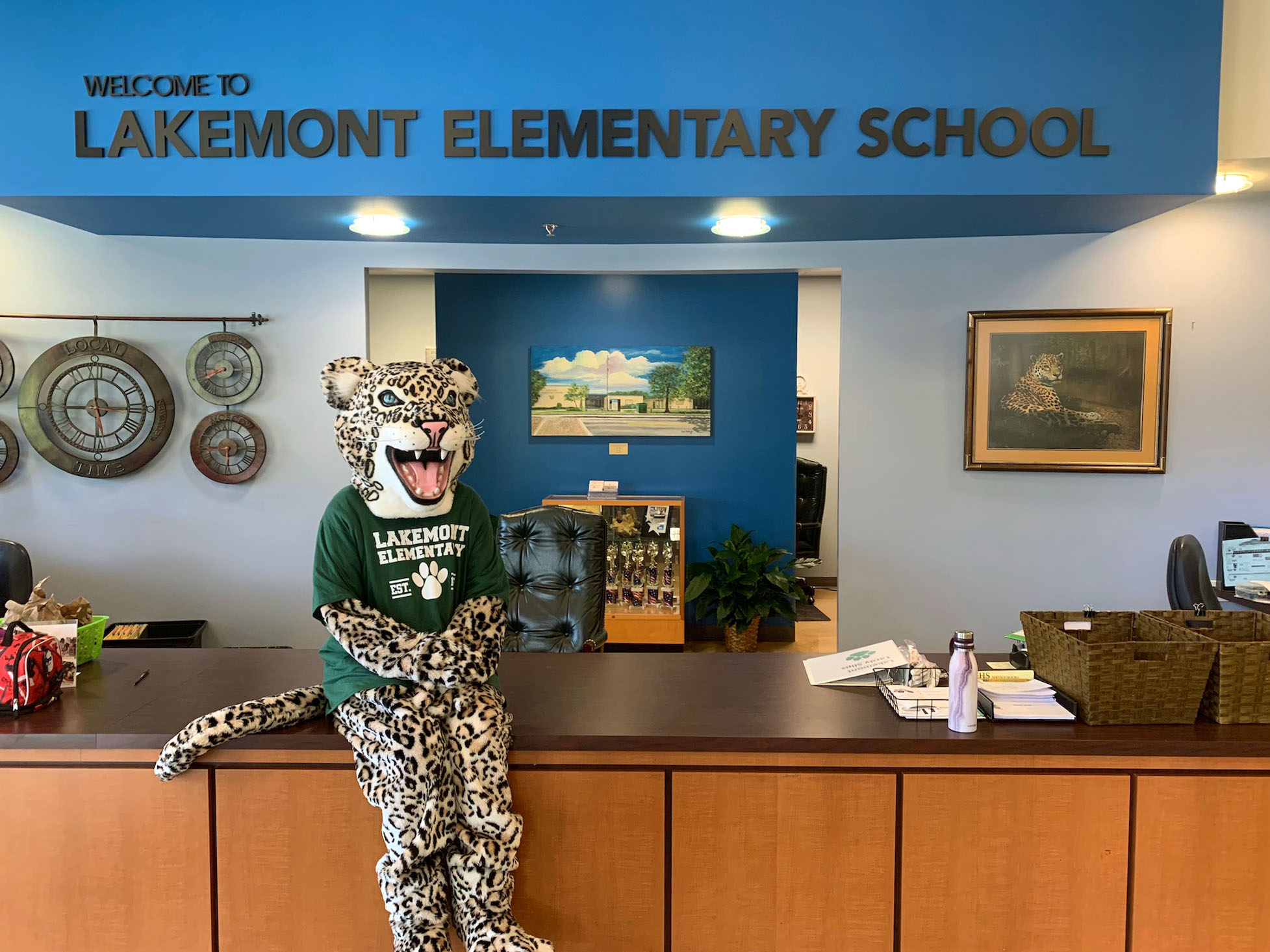 Leo the Leopard mascot sits at the Lakemont Elementary School front desk.