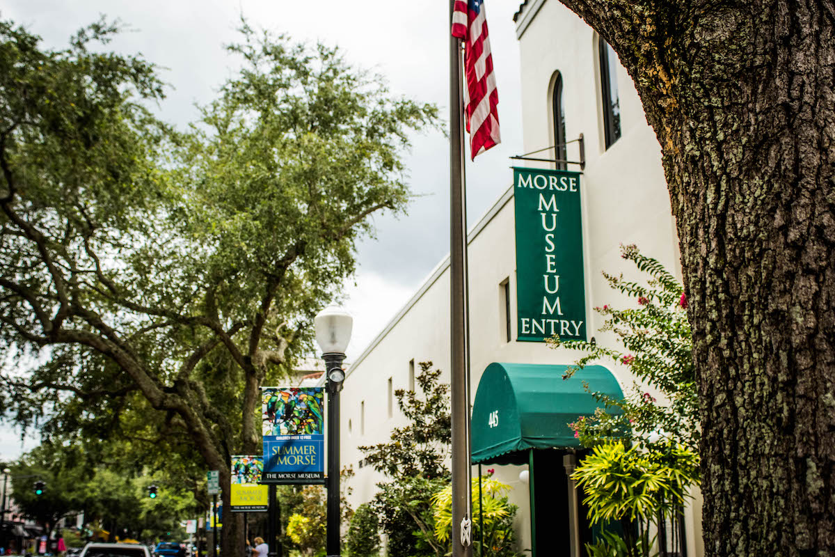white building, American flag, and green Morse Museum sign