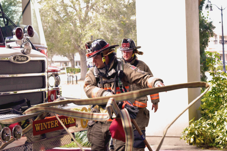 Two WPFD firefighters work on hose training.