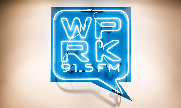 Blue neon sign that reads WPRK 91.5 FM.